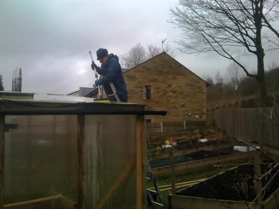 John grime busting on the greenhouse roof