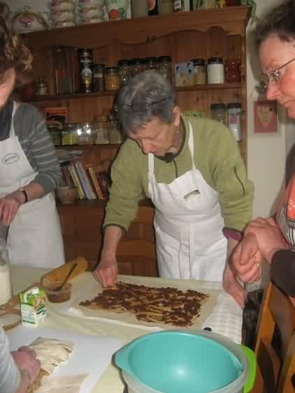 Elizabeth spread tapenade and cheese onto puff pastry
