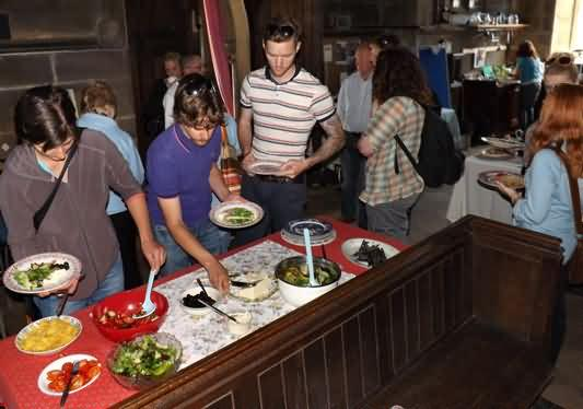 Visitors from Hull grab some lunch of salad, Todmorden cheese, humus from the bear, saker bread and olives