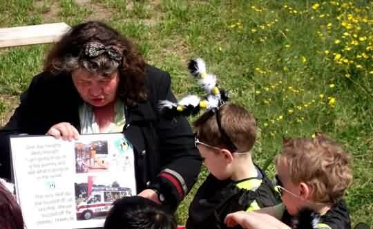 Mary and the young bumble boys listen to story