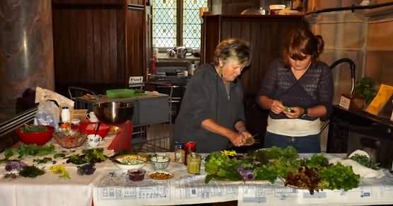 Hilary and Laura prepare salad picked entirely from the town centre