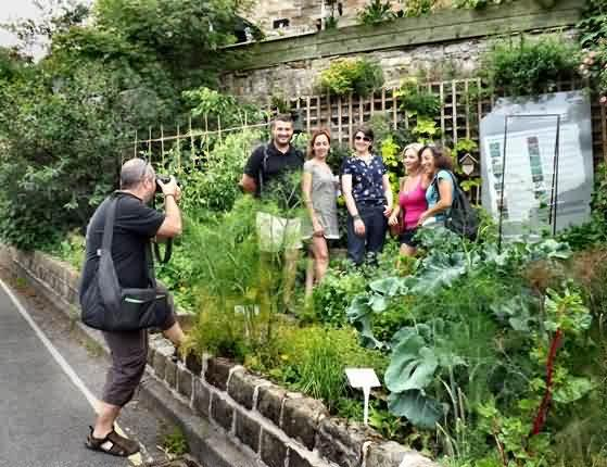 visitors from Spain at Mary's sharing garden