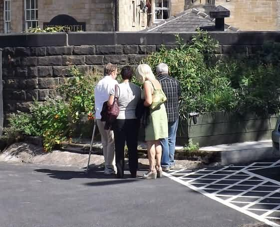 visitors exploring the growing beds for themselves