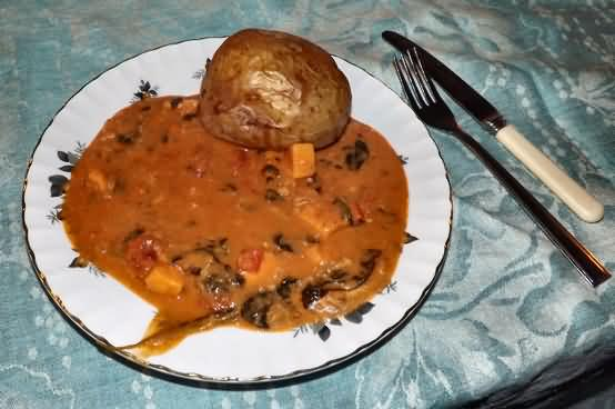 Baked potato with groundnut stew