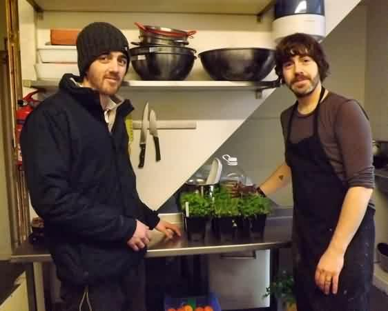 Danny delivers herbs to Scott in the Bear cafe kitchen
