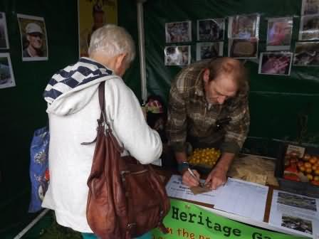 john explains the important of heritage seed saving and gives away packets of seeds
