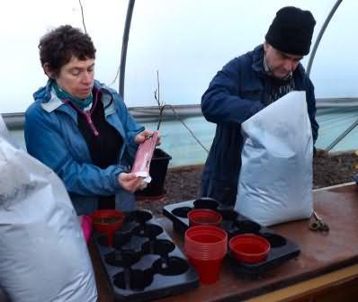 Jude and Peter sort the pots labels and compost