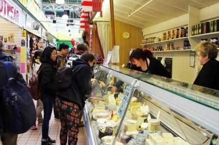 vegetable tourists buying Todmorden cheese
