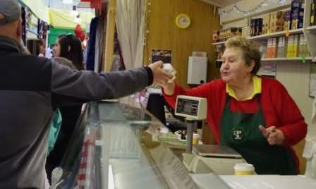 visitors from Liverpool buy Todmorden cheese
