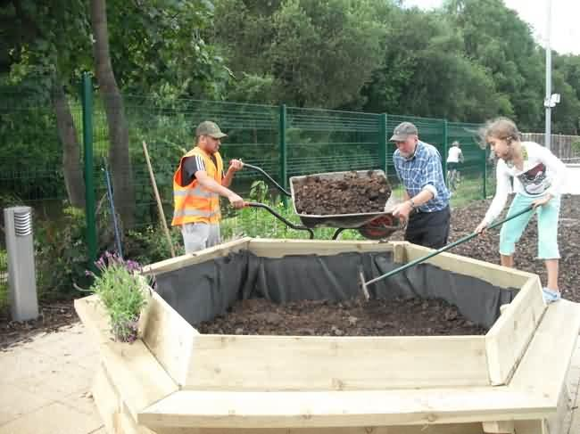 filling the Health centre planters